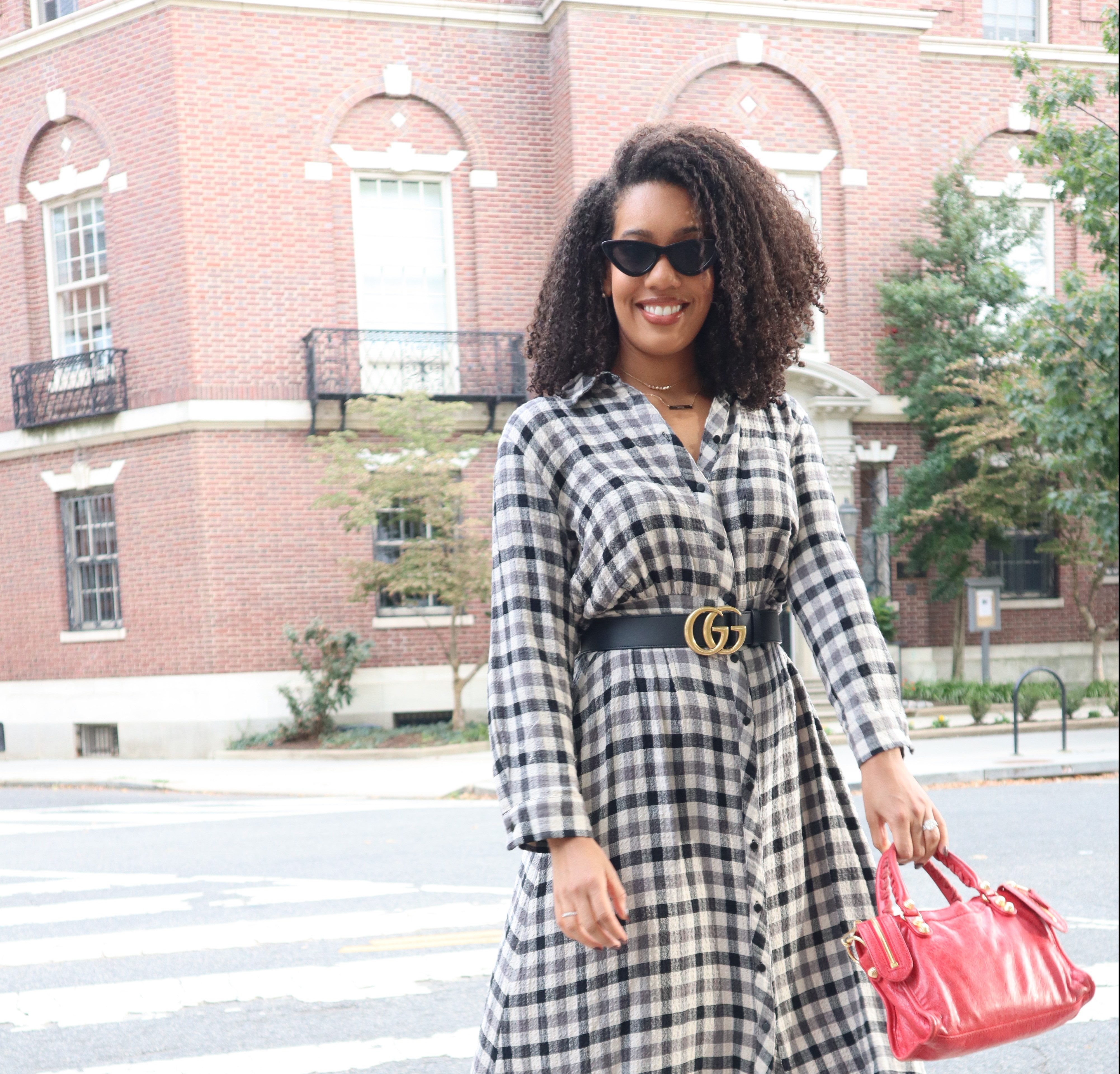 girl in gucci belt, red purse, checkered dress